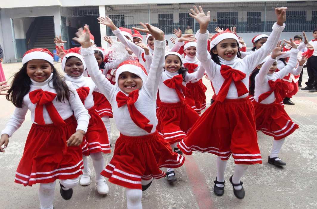 JOYFUL, JOYFUL: Children celebrate Christmas in school in Patna, UNI