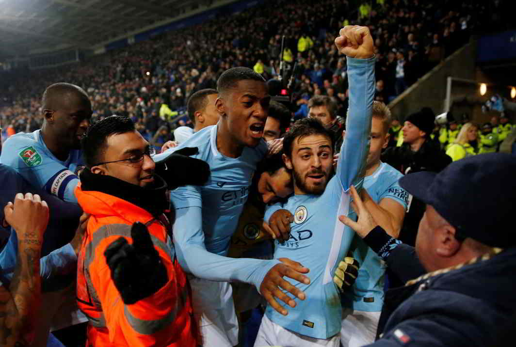 DISAPPOINTING THE HOME CROWD: Manchester City's Claudio Bravo celebrates with Tosin Adarabioyo and Bernardo Silva after winning the penalty shootout during the Carabao Cup quarterfinal against Leicester City in King Power Stadium, Leicester, Britain, Reuters/UNI