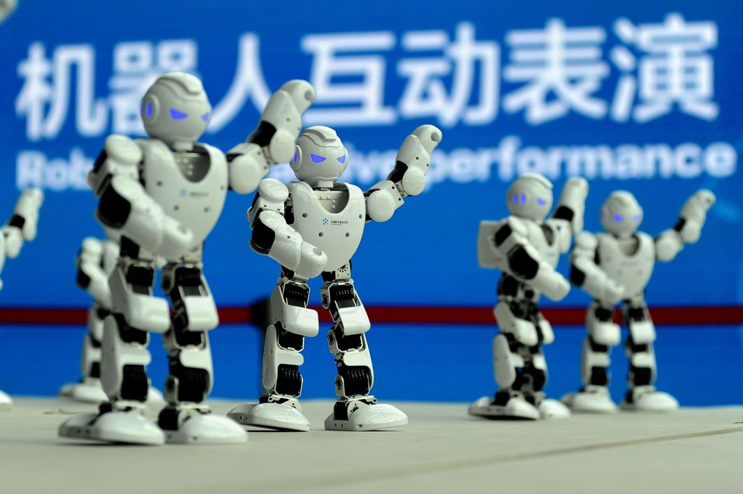 I, ROBOT: Humanoid robots developed by UBTECH perform a synchronised dance at the World Intelligent Manufacturing Summit in Nanjing, Jiangsu province, China, Reuters/UNI