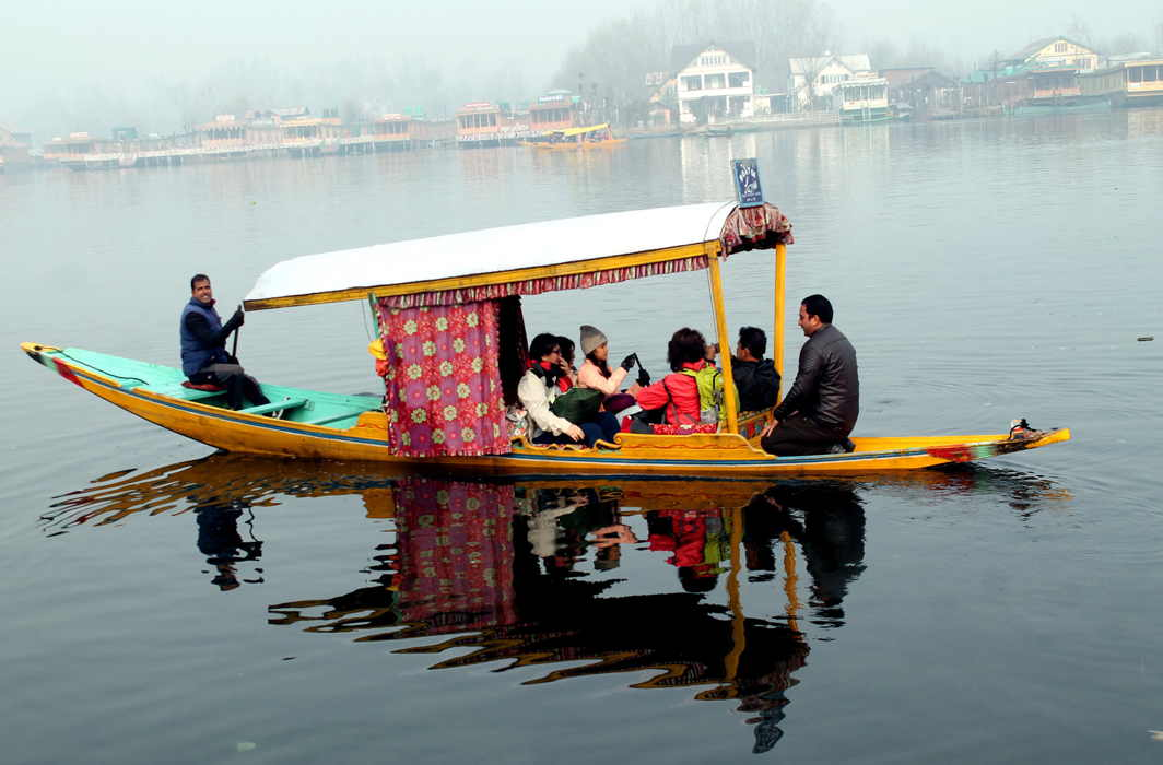 RECREATION: Foreigners enjoy a shikara ride in the world famous Dal Lake, during a cold winter morning in Srinagar, UNI