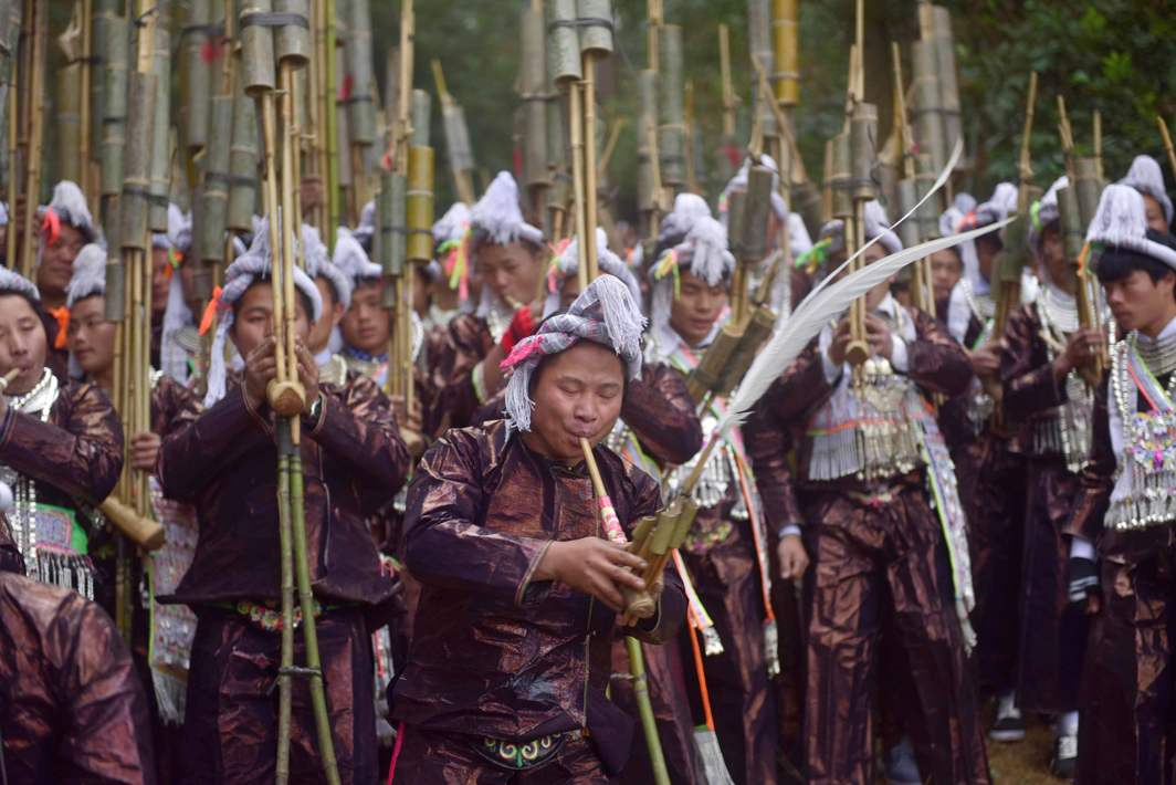 HEAR THE BRAVES PLAY: Men of the Miao ethnic group play the instrument as they celebrate the Lusheng Festival in Congjiang, Guizhou province, China, Reuters/UNI