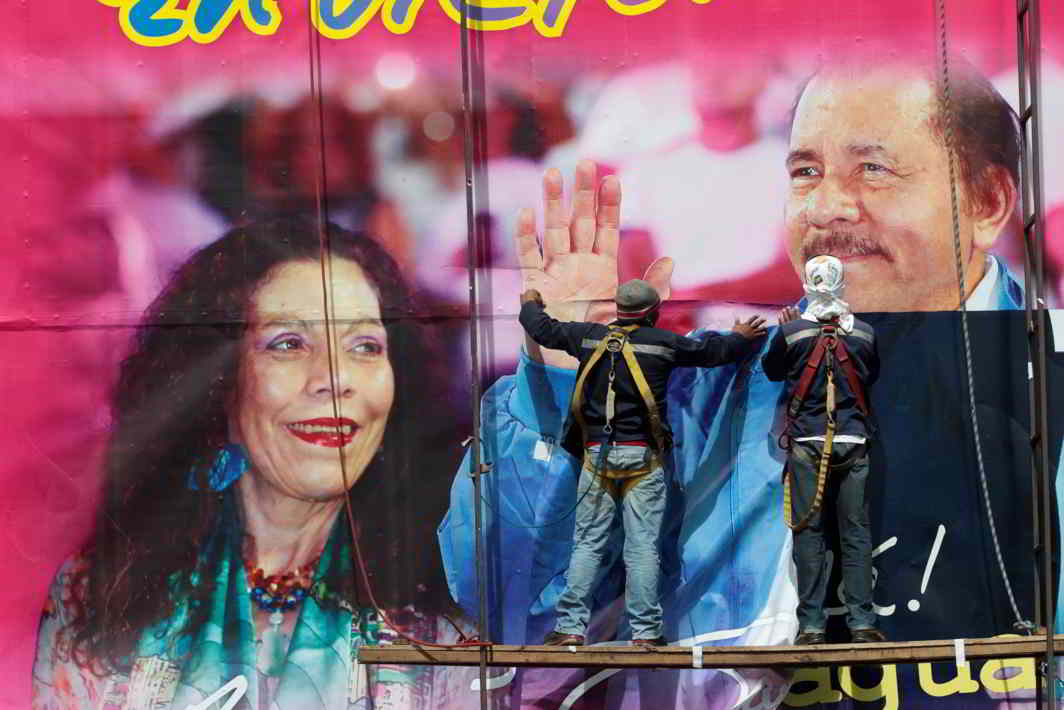 FIRST FAMILY: Workers put up a billboard with the image of Nicaragua's President Daniel Ortega and Vice-President and First Lady Rosario Murillo in Managua, Nicaragua, Reuters/UNI