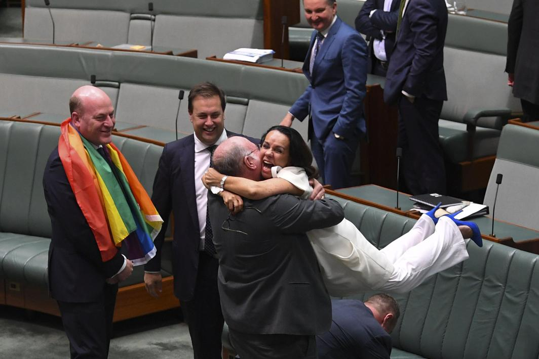 A MORE EQUAL PLANET: Liberal MP Warren Entsch lifts up Labour MP Linda Burney in celebration after the passing of the Marriage Amendment Bill in the House of Representatives at Parliament House in Canberra, Lukas Coch/AAP/Reuters/UNI