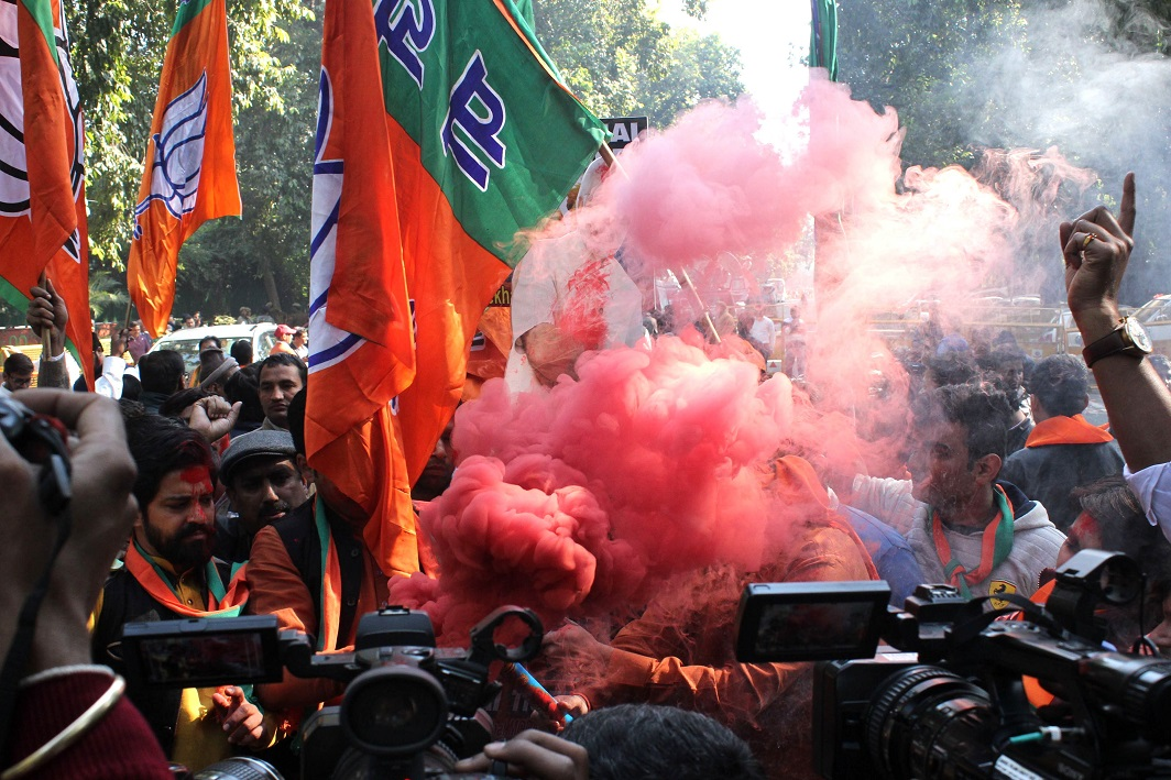 SAFFRON RAGE: BJP workers celebrate their party's victory in the Gujarat and Himachal Pradesh assembly elections at the BJP headquarters in New Delhi, UNI