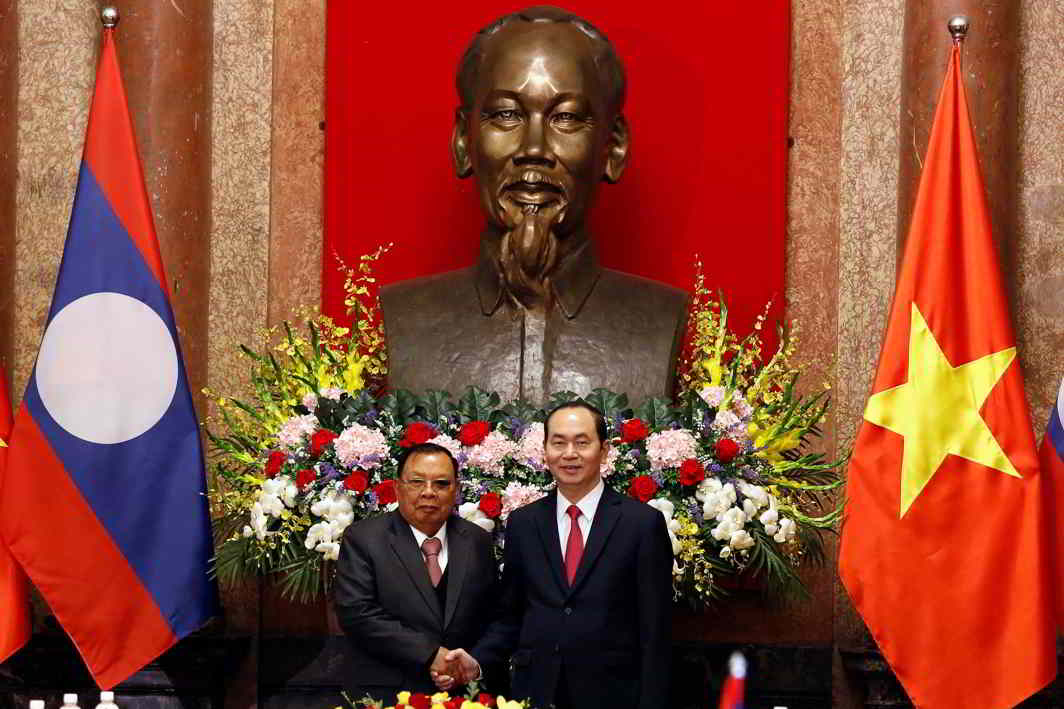 UNDER HIS SHADOW: Laos' President Bounnhang Vorachith meets Vietnam's President Tran Dai Quang at the Presidential Palace in Hanoi, Vietnam, Reuters/UNI
