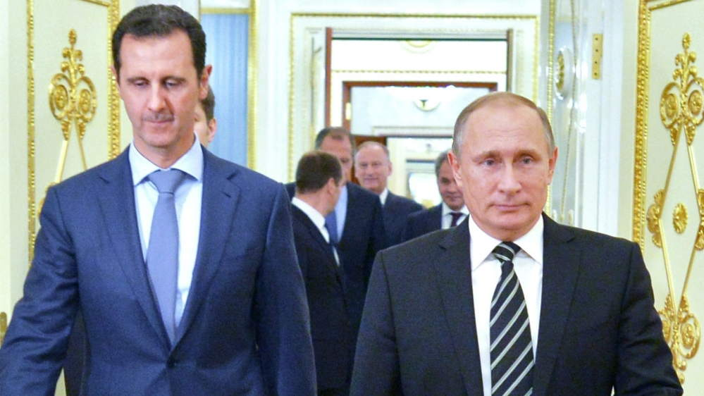 Putin announces beginning of Russian withdrawal during surprise visit to Syria