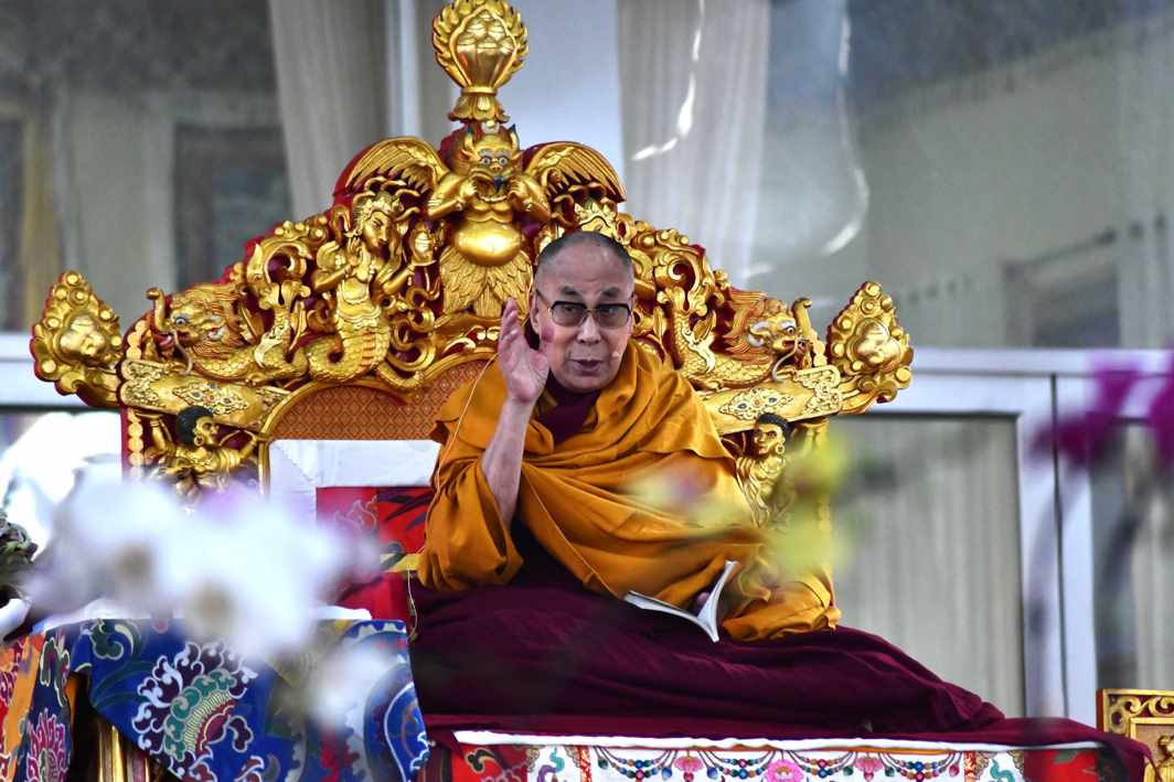 MASTER'S VOICE: Tibetan spiritual leader the 14th Dalai Lama speaks to disciples during the second day of his teaching session at Kalachakra Ground in Bodhgaya, UNI