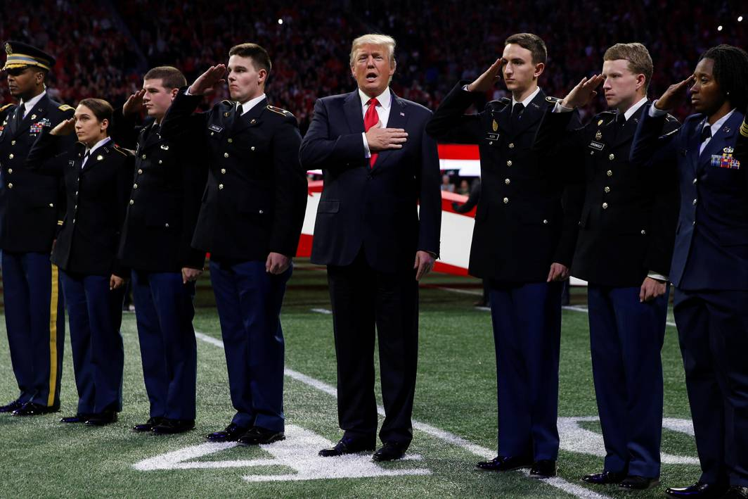 HIS TURN TO CANTAN: US President Donald Trump, flanked by ROTC students, sings along with the national anthem before the NCAA College Football Playoff Championship game between Alabama and Georgia in Atlanta, Georgia, US, Reuters/UNI