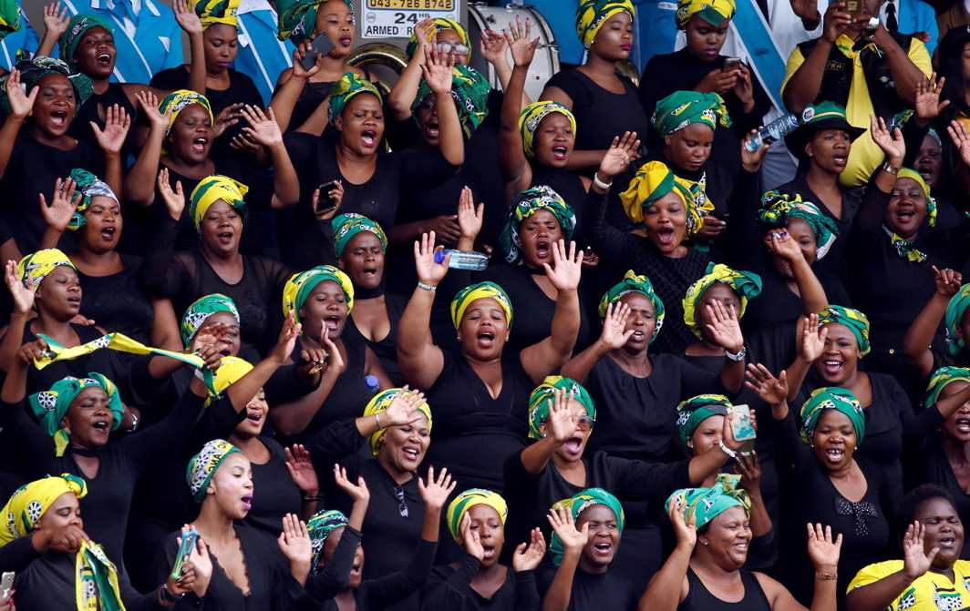 PROUD LEGACY: Supporters of the African National Congress sing ahead of the party's 106th anniversary celebrations, in East London, South Africa, Reuters/UNI