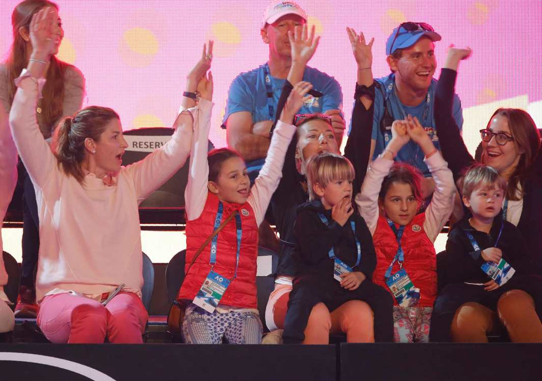 TENNIS MOM: Mirka Federer, wife of Roger of Switzerland, raises hands with their children as the family attends Kids Tennis Day before the Australian Open tennis tournament at the Rod Laver Arena, Melbourne, Reuters/UNI