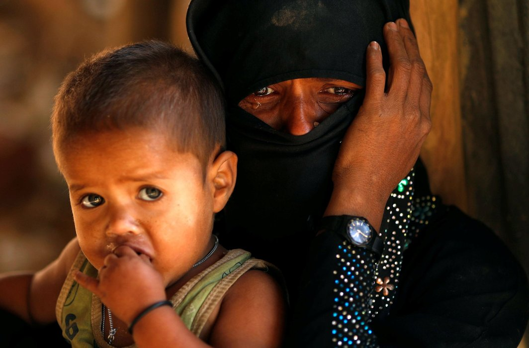 NO REDRESS: A Rohingya refugee cries next to her son outside a temporary mosque at Kutupalong refugee camp, near Cox's Bazar, Bangladesh, Reuters/UNI