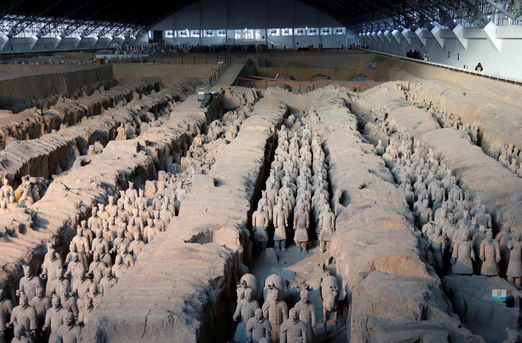 RICH FIND: Terracotta warriors and horses, which were unearthed during the first excavation from 1978 to 1984, stand inside the No. 1 pit of the Museum of Qin Terracotta Warriors and Horses in Xian, Shaanxi province, in China, Reuters/UNI