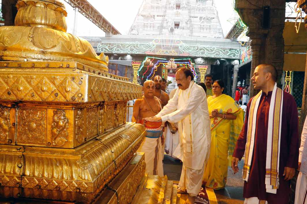 GOLDEN TOUCH: Vice-President M Venkaiah Naidu offers prayers at Lord Venkateswara temple in Tirumala, UNI
