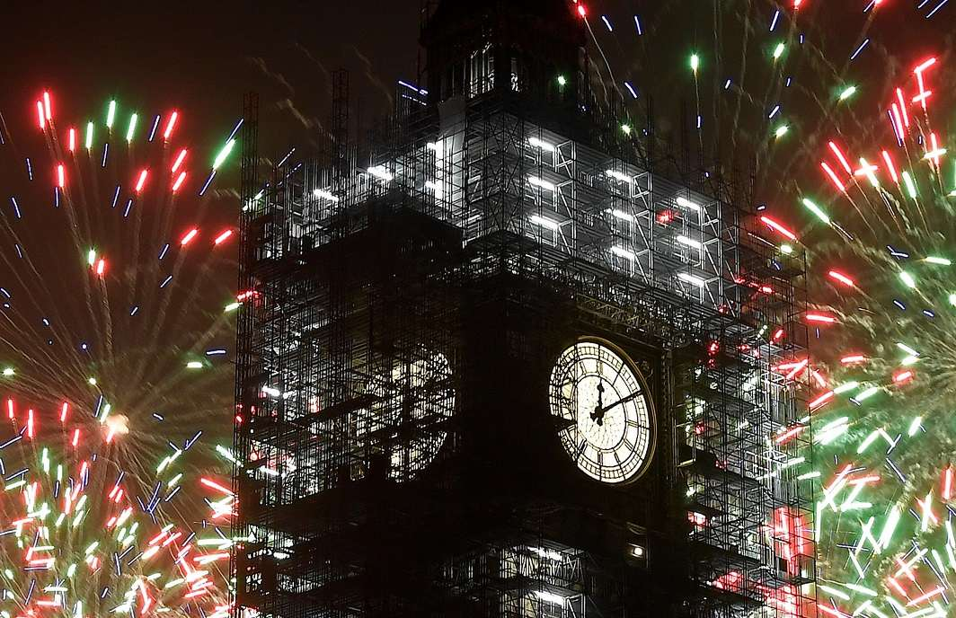 CINDERELLA HOUR: Fireworks explode behind Elizabeth Tower, commonly known as Big Ben, during New Year's Eve celebrations in London, Britain, Reuters/UNI