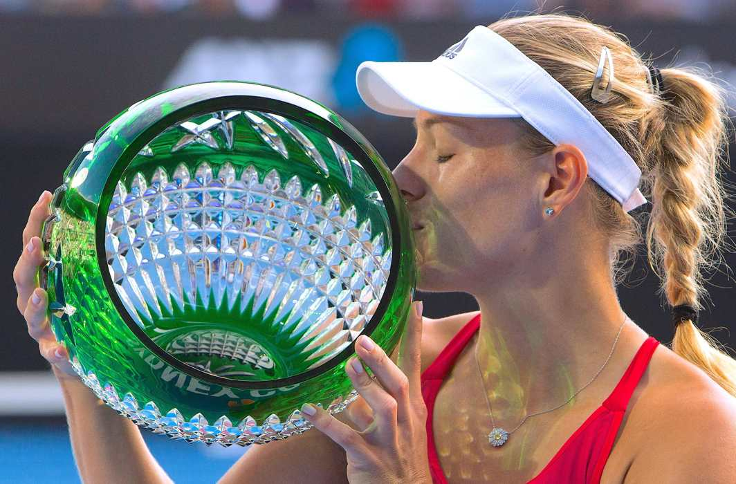 IN FIGHTING FORM: Germany's Angelique Kerber kisses the trophy after winning the final of the Sydney International Tournament against Australia's Ashleigh Barty, Reuters/UNI