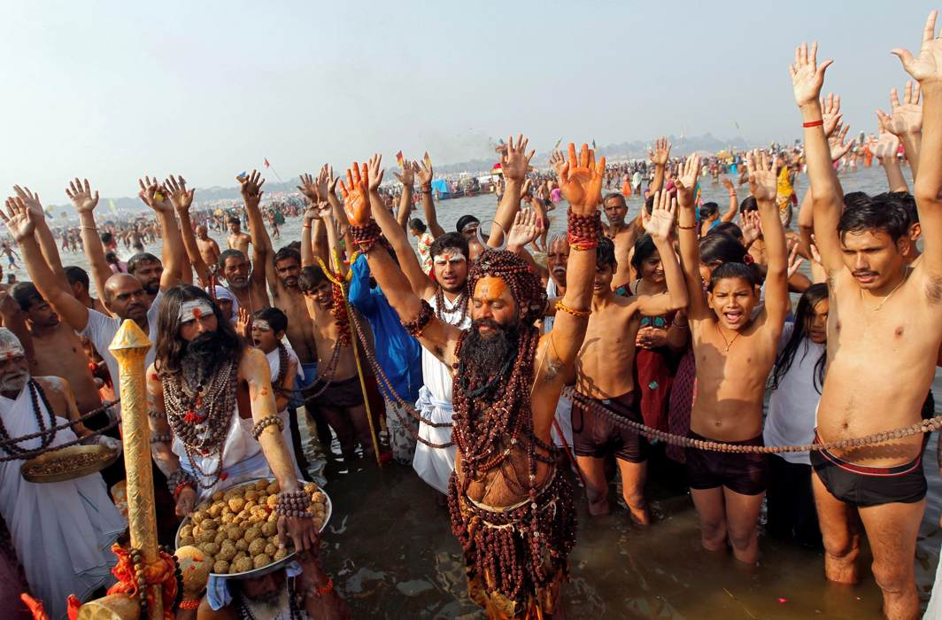 BRAVING DISCOMFORT: Sadhus and devotees pray as they take a holy dip at Sangam, the confluence of the Ganges, Yamuna and Saraswati rivers, during Magh Mela festival in Allahabad, Reuters/UNI