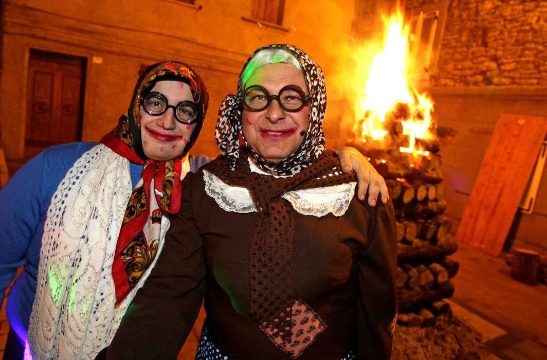 "CROSS-DRESS: People dressed as ""Befane"" pose in Castell'Azzara, Italy, Reuters/UNI"