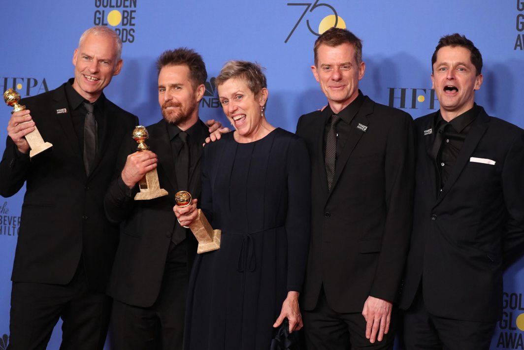"""WATCH OUT FOR IT: Martin McDonagh (L) poses backstage with cast and producers of """"Three Billboards Outside Ebbing, Missouri"""" after winning for Best Motion Picture, Drama, during the 75th Golden Globe Awards at Beverly Hills, California, US, Reuters/UNI"""