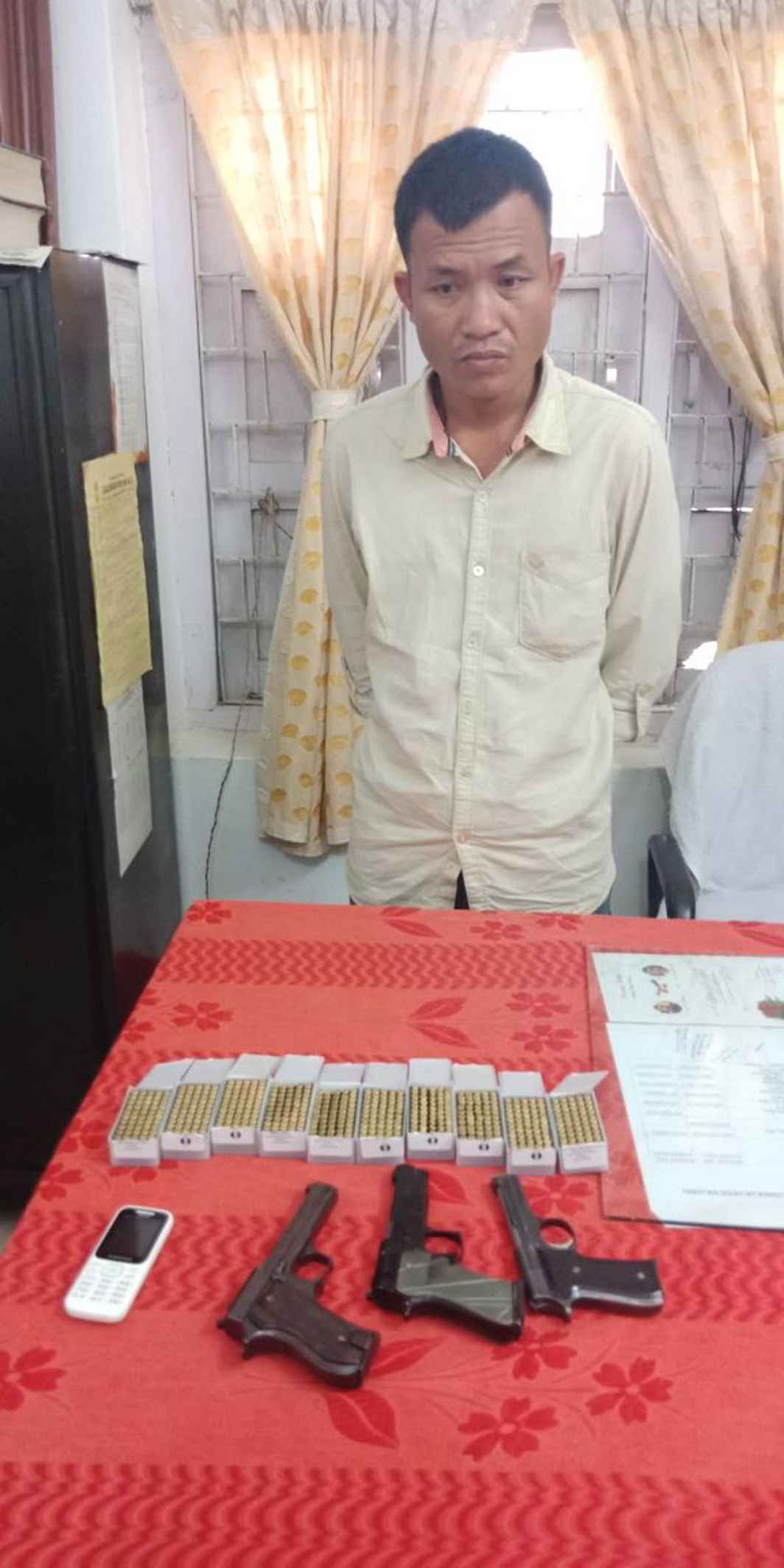 CAUGHT RED-HANDED: Naresh Chakma (40) arrested from Agartala railway station with a huge cache of arms being produced at a press conference, UNI