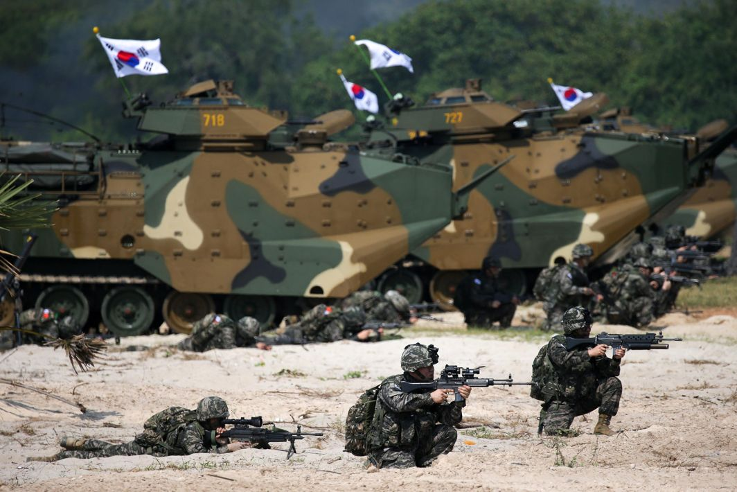 FIGHT BACK: South Korean marines participate in an amphibious assault exercise as part of the