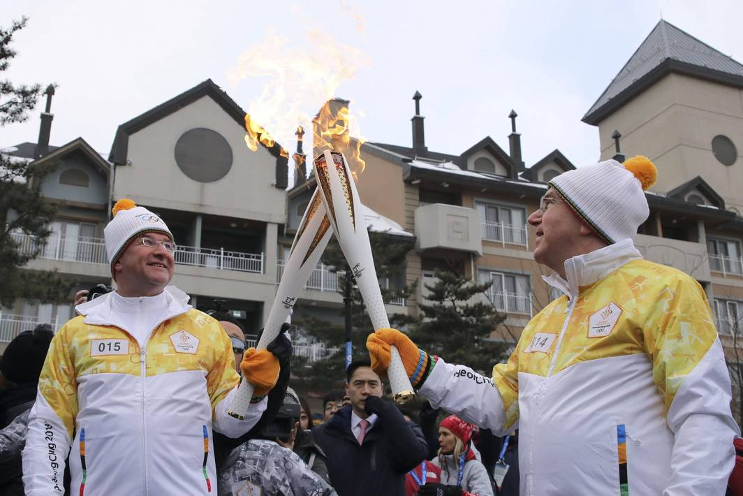LET THE GAMES BEGIN: President of the International Olympic Committee Thomas Bach and United Nations President of the General Assembly, Miroslav Lacjak, take part in the PyeongChang 2018 Torch Relay ahead of the start of the games in Pyeongchang, South Korea, Reuters/UNI