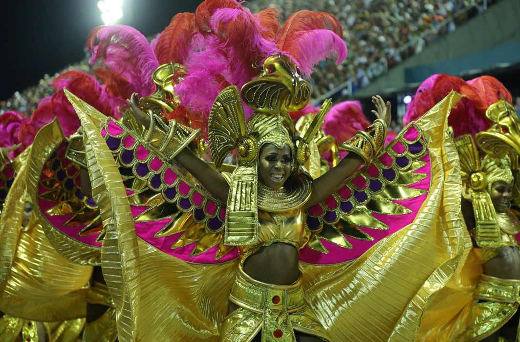 COVERED IN GOLD: A reveller from Salgueiro performs during the second night of the Carnival parade at the Sambadrome in Rio de Janeiro, Brazil, Reuters/UNI