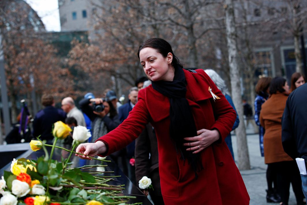 IN MEMORIAM: A woman leaves a rose at a commemoration ceremony of the 25th anniversary of the 1993 World Trade Center bombing at the north reflecting pool of the National September 11 Memorial & Museum at the World Trade Center site in the Manhattan borough of New York, US, Reuters/UNI