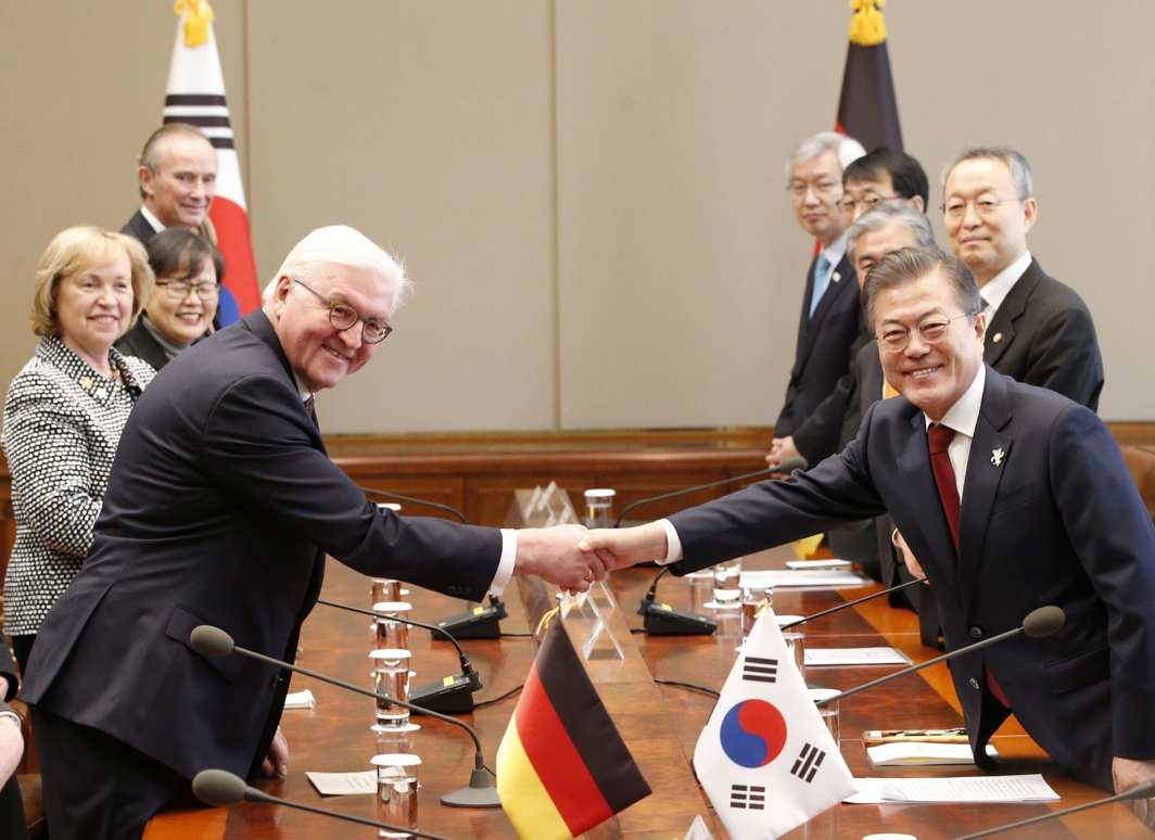 WELL BEGUN: German President Frank-Walter Steinmeier shakes hands with South Korean President Moon Jae-in prior to their meeting at the presidential office Cheong Wa Dae, Blue House in Seoul, South Korea. Swiss Federal President Alain Berset began his five-day visit to South Korea to attend the opening ceremony of the Olympic Winter Games in Pyeongchang, Reuters/UNI