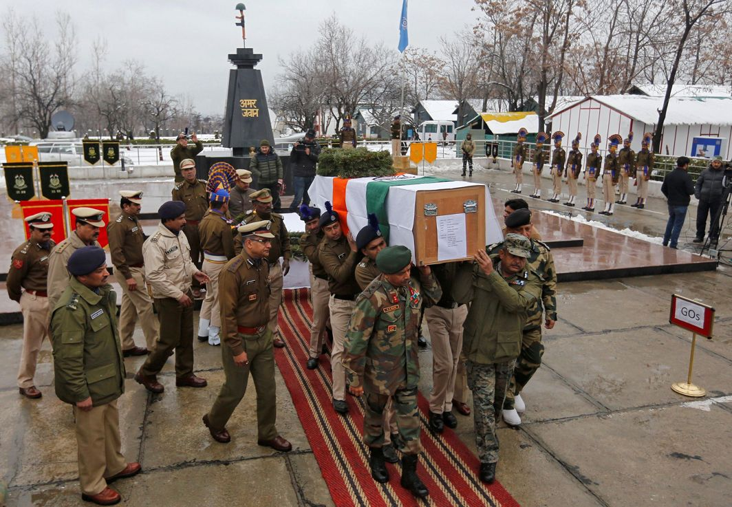 A LIFE LOST: Police officers carry the coffin containing the body of a policeman who, according to local media reports, was killed in a gunbattle with suspected militants, during a wreath laying ceremony on the outskirts of Srinagar, Reuters/UNI