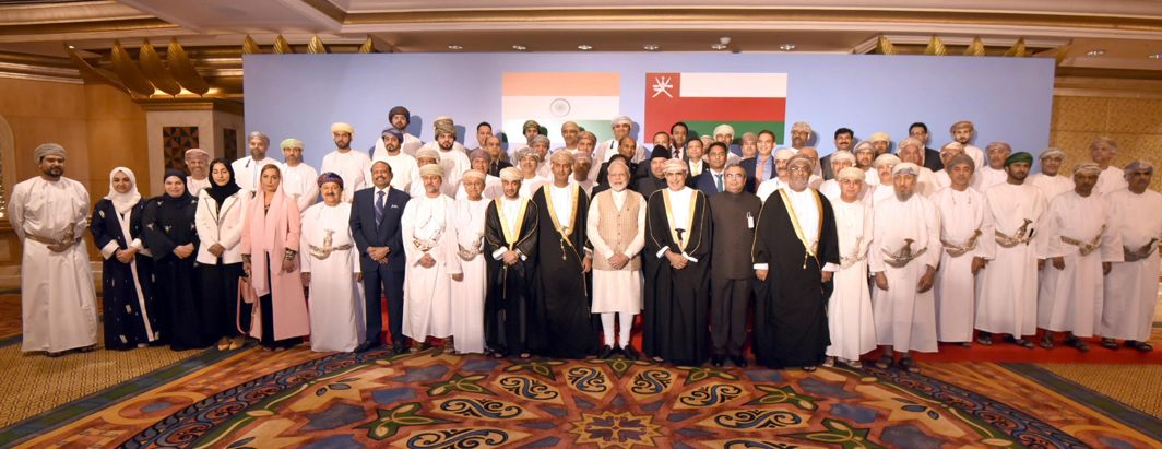 SHOW OF AMITY: Prime Minister Narendra Modi in a group photograph at the Oman-India Business Meet, in Muscat, Oman, UNI