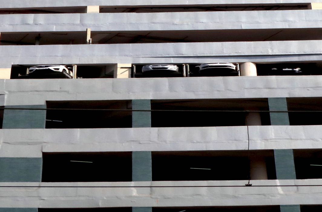 QUEER VIEW: Cars seen through openings of the parking lot at a high-rise in Mumbai, UNI