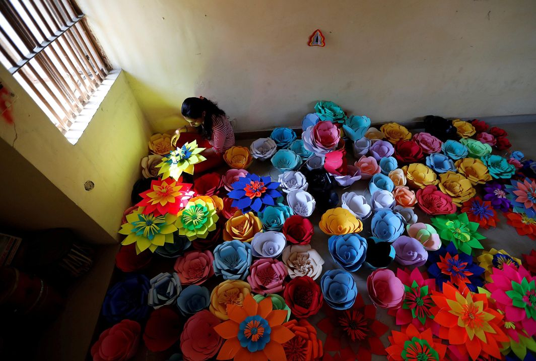 UNCELEBRATE: An inmate at Tihar Jail, the largest complex of prisons in South Asia, makes decorations for an event to mark International Women's Day in New Delhi, Reuters/UNI