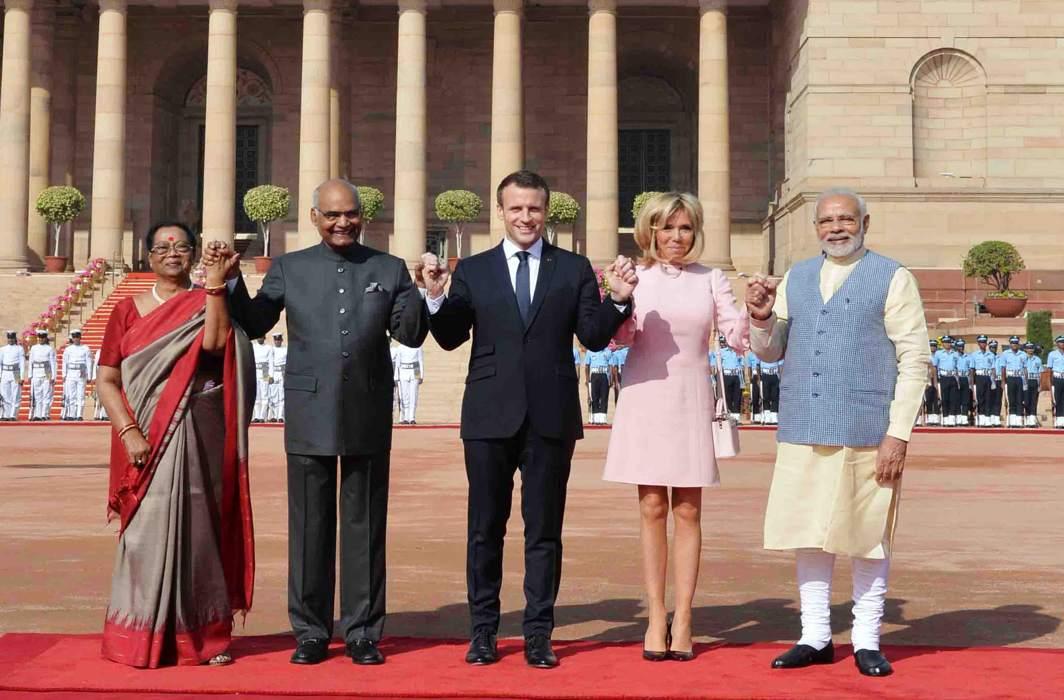 SHOW OF FRIENDSHIP: French President Emmanuel Macron (centre), his wife Brigitte Macron (second right) President Ramnath Kovind (second left) his wife Savita Kovind (left) and Prime Minister Narendra Modi hold hands during Macron's ceremonial reception at Rashtrapati Bhavan, in New Delhi, UNI