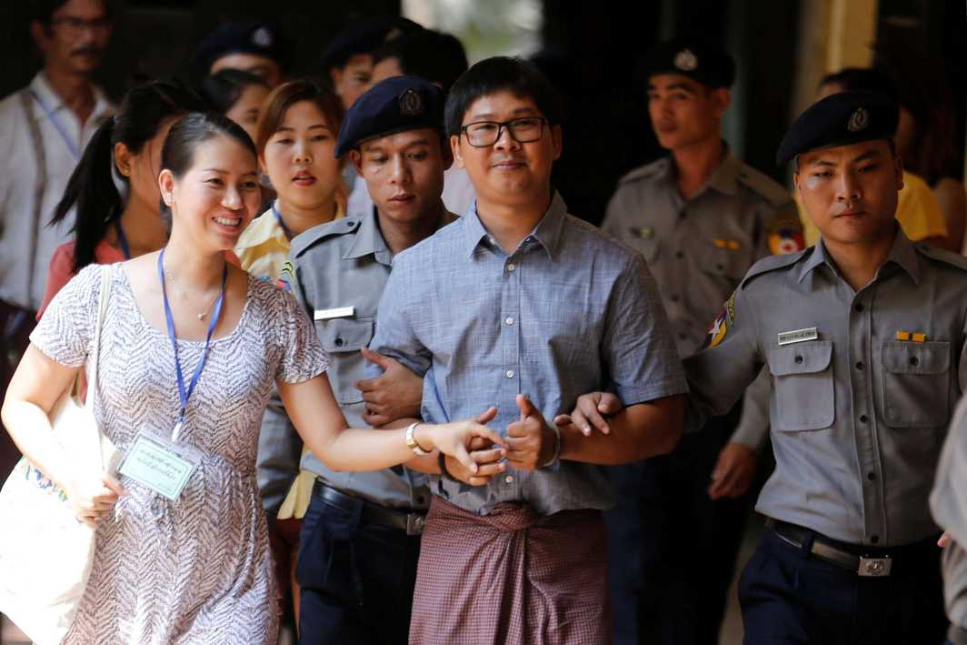 SANS SUPPORT: Detained Reuters journalist Wa Lone is escorted by police before a court hearing in Yangon, Myanmar, Reuters/UNI