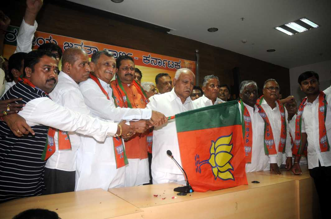LINGAYAT LEADER: BJP state president BS Yeddyurappa welcomes Congress, JD(S) and Independent MLCs who have joined the party in Bengaluru, UNI