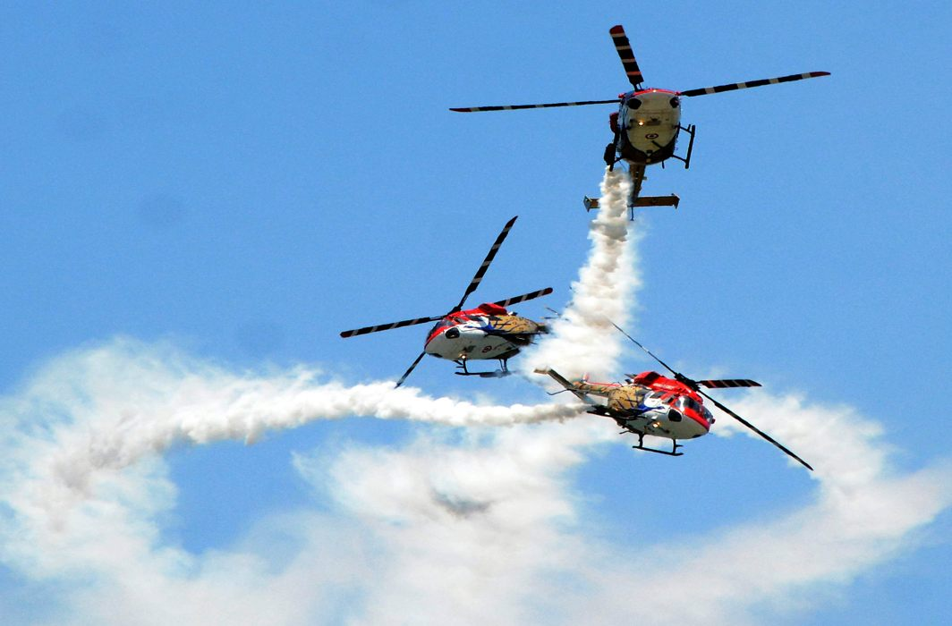 ACROBATICS: A Sarang helicopter display team of the Indian Air Force performs during the DefExpo-2018 at Thiruvidanthai, about 50 km from Chennai, UNI