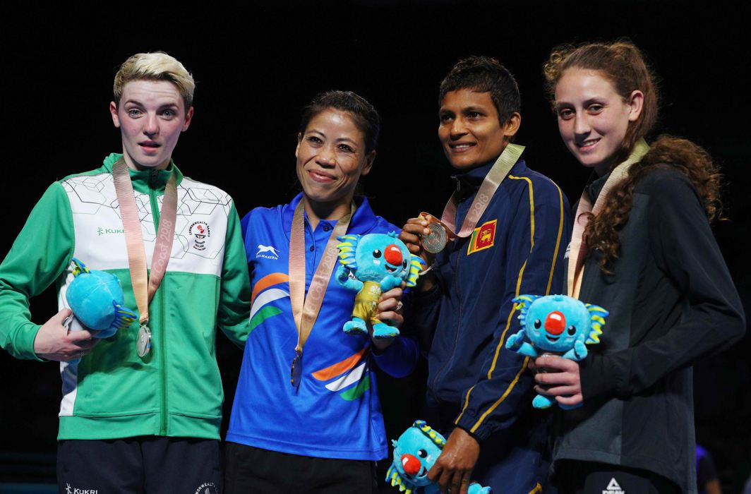 Gold medallist MC Mary Kom of India, silver medallist Kristina O'Hara of Northern Ireland, and bronze medallists Anusha Dilrukshi Koddithuwakku of Sri Lanka and Tasmyn Benny of New Zealand at Oxenford Studios, Gold Coast, Australia, Reuters/UNI