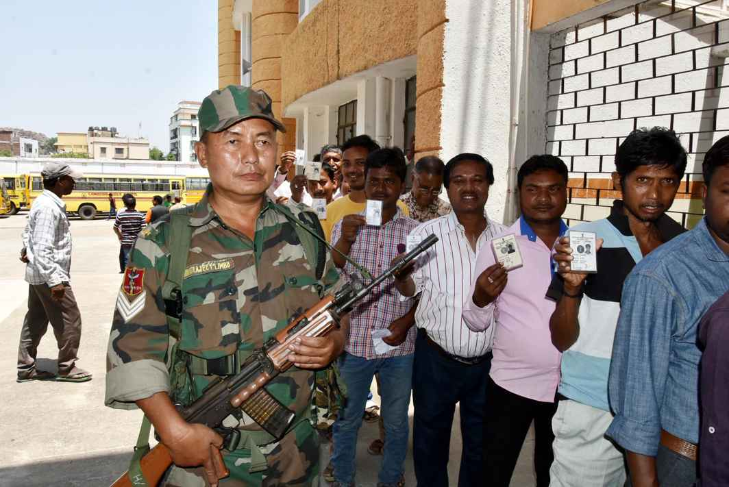 KEEPING IT FREE: A security personal stands guard at a polling station during Ranchi municipality elections in Ranchi, Jharkhand, UNI