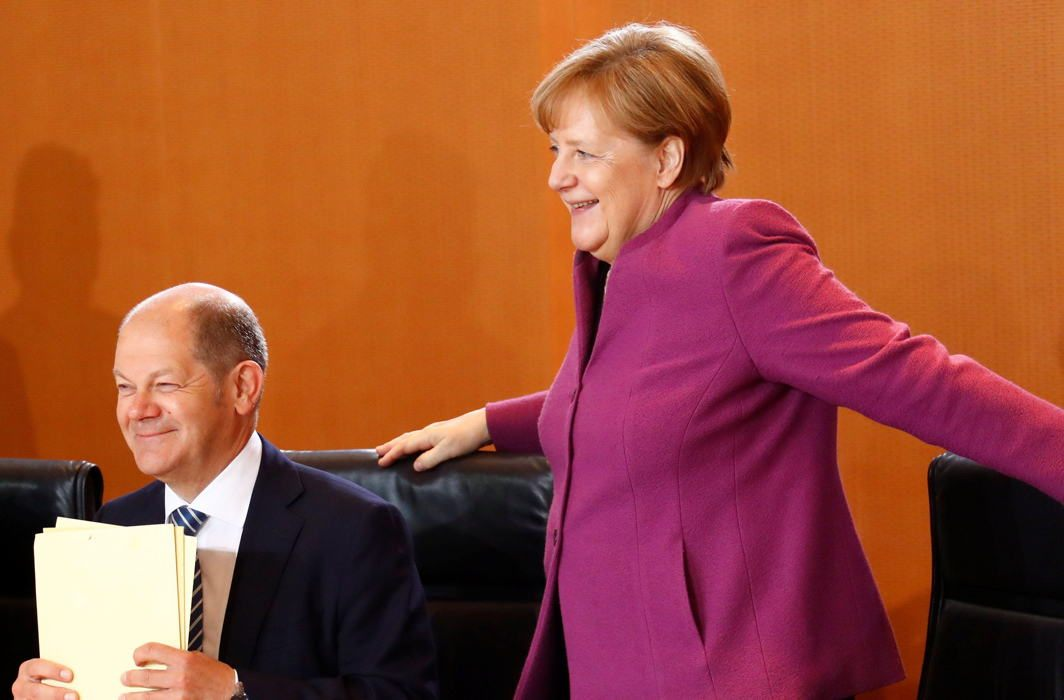 German Chancellor Angela Merkel and Finance Minister and vice-chancellor Olaf Scholz attend the weekly cabinet meeting in Berlin, Germany, Reuters/UNI