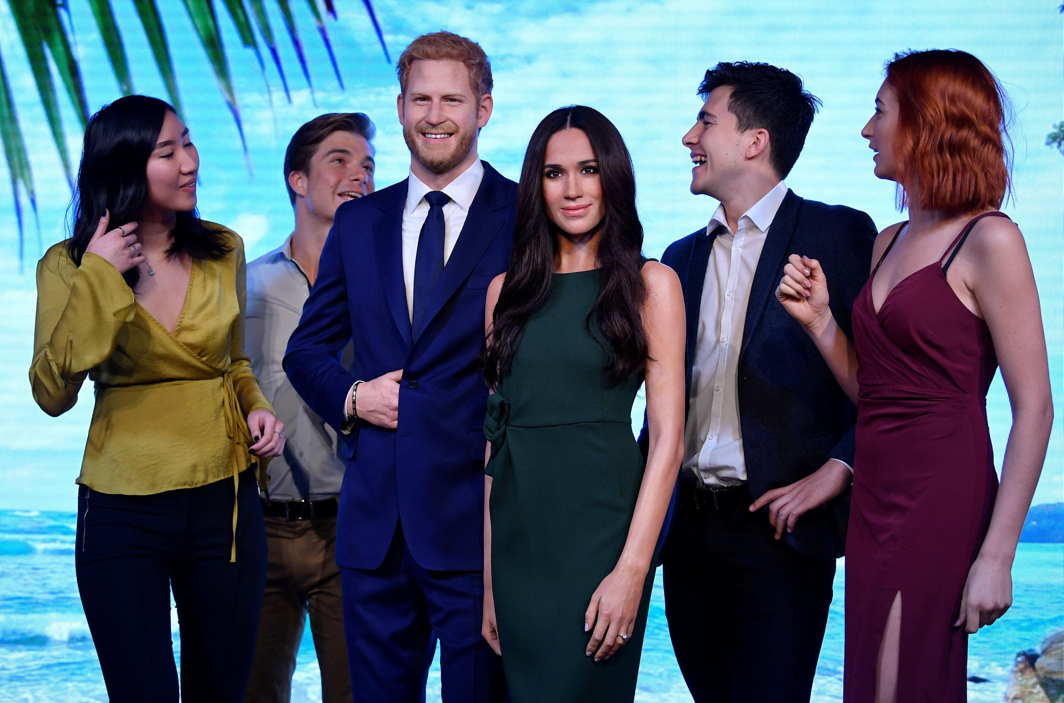 Models pose with waxwork representations of Britain's Prince Harry and his fiancee Meghan Markle, seen on display at Madame Tussauds in London, Britain, Reuters/UNI