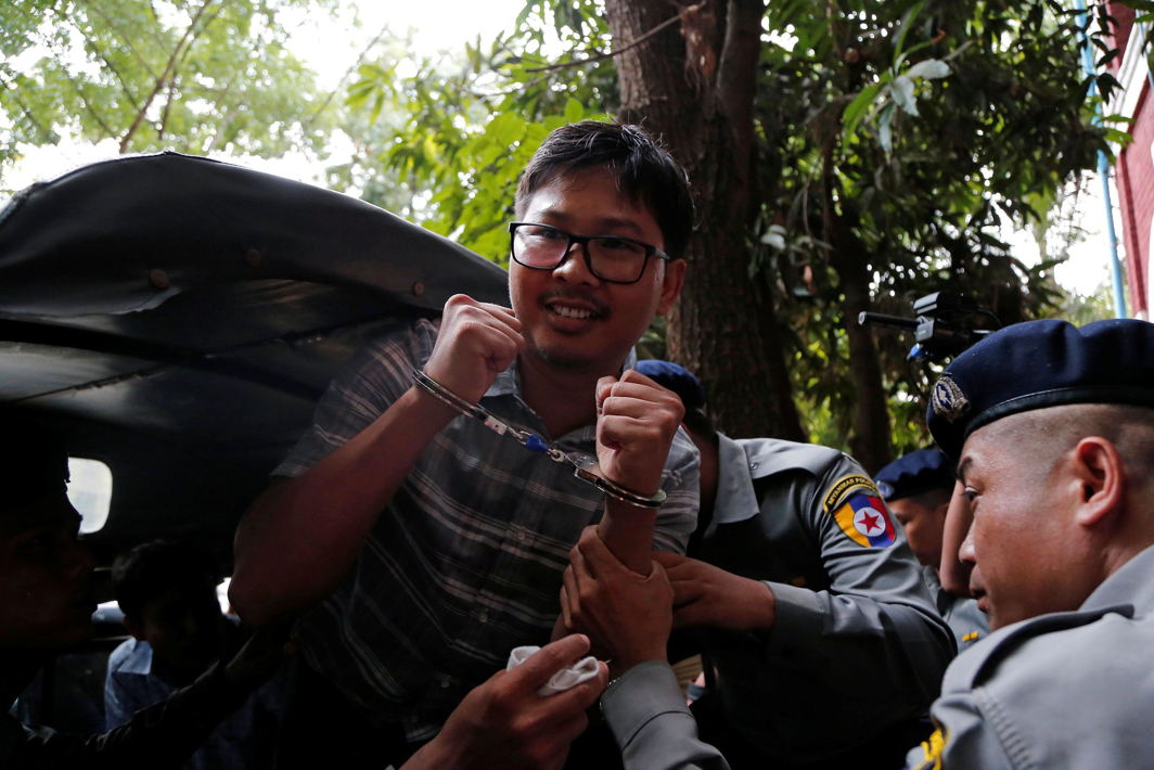 Detained Reuters journalist Wa Lone is escorted by police while leaving after a court hearing in Yangon, Myanmar, Reuters/UNI
