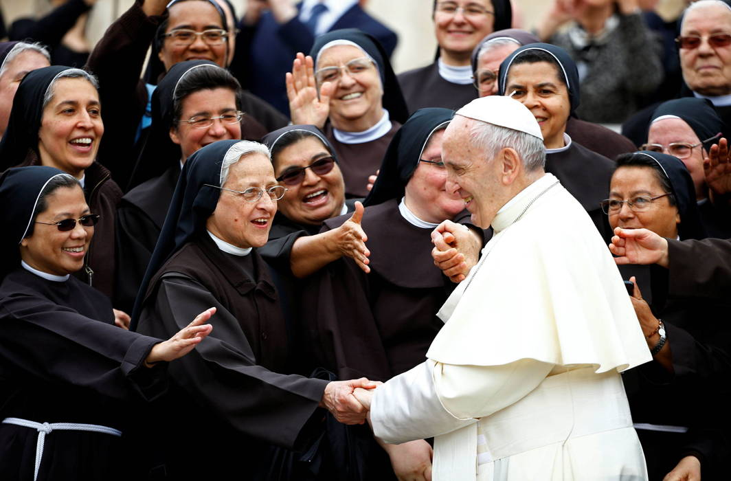 Pope Francis greets a group of nuns at the end of his Wednesday general audience in Saint Peter's square at the Vatican, Reuters/UNI
