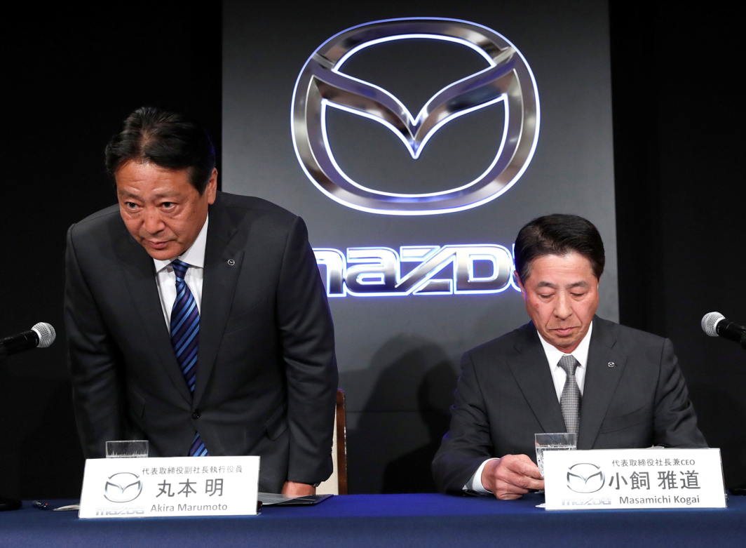 Mazda Motor Corp. outgoing President Masamichi Kogai and next president Akira Marumoto attend a news conference in Tokyo, Japan, Reuters/UNI