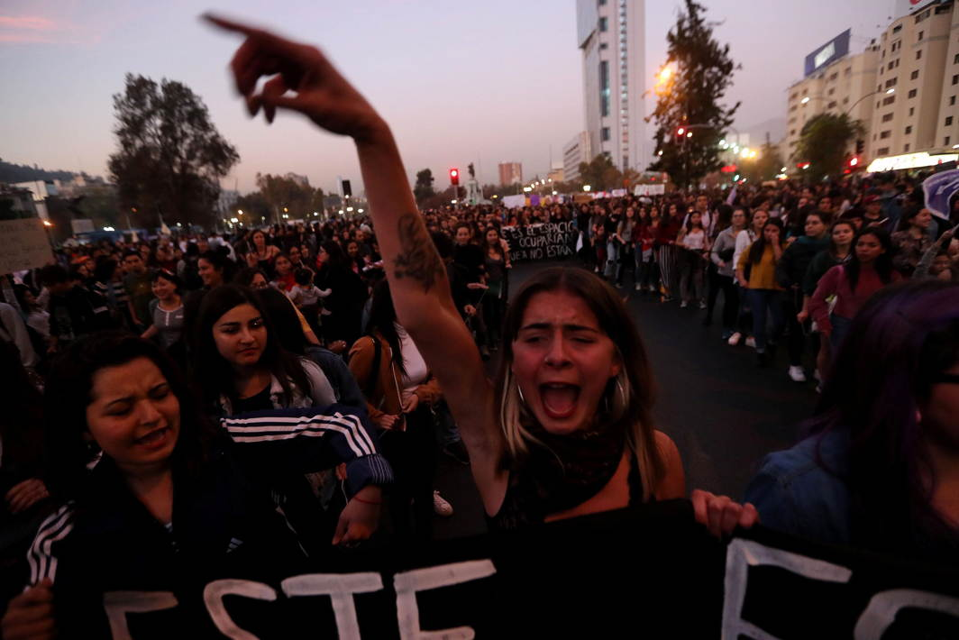 A woman shouts slogans during a rally against gender violence in Santiago, Chile, Reuters/UNI