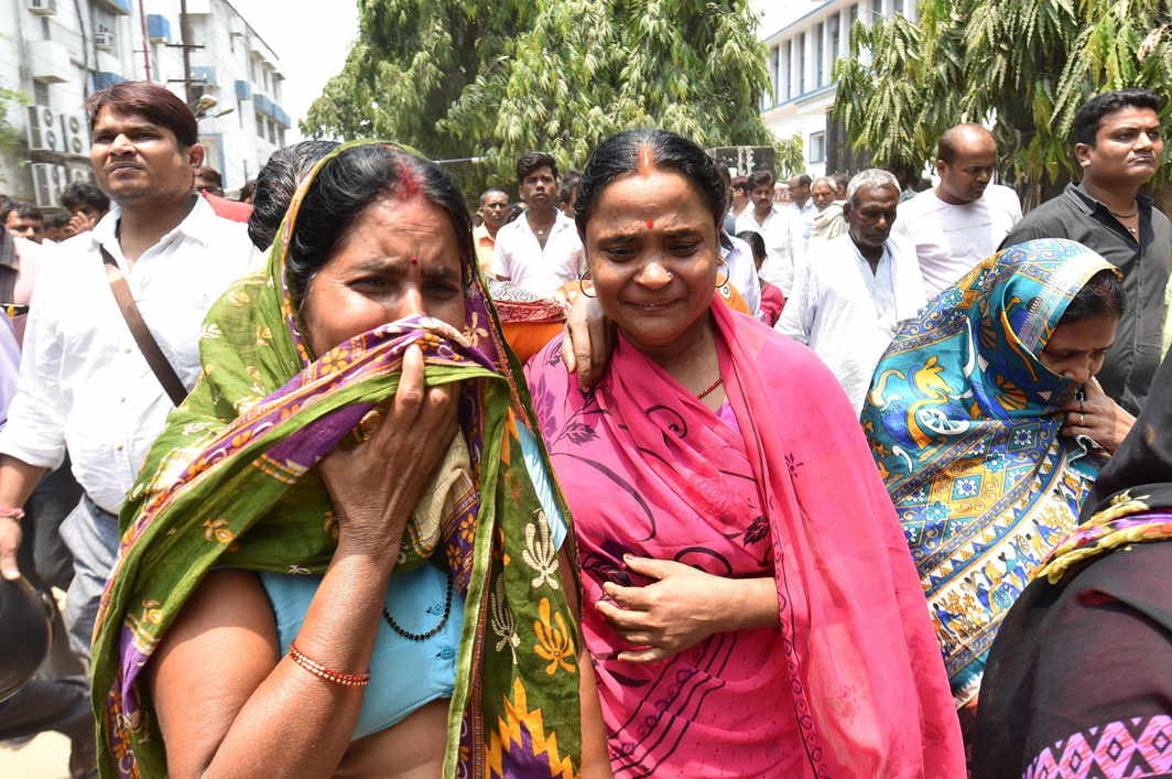 Relatives mourn after Rashtriya Janata Dal leader Dina Gope killed by unidentified gunmen when he was returning home after attending a relative's marriage, in Patna, UNI