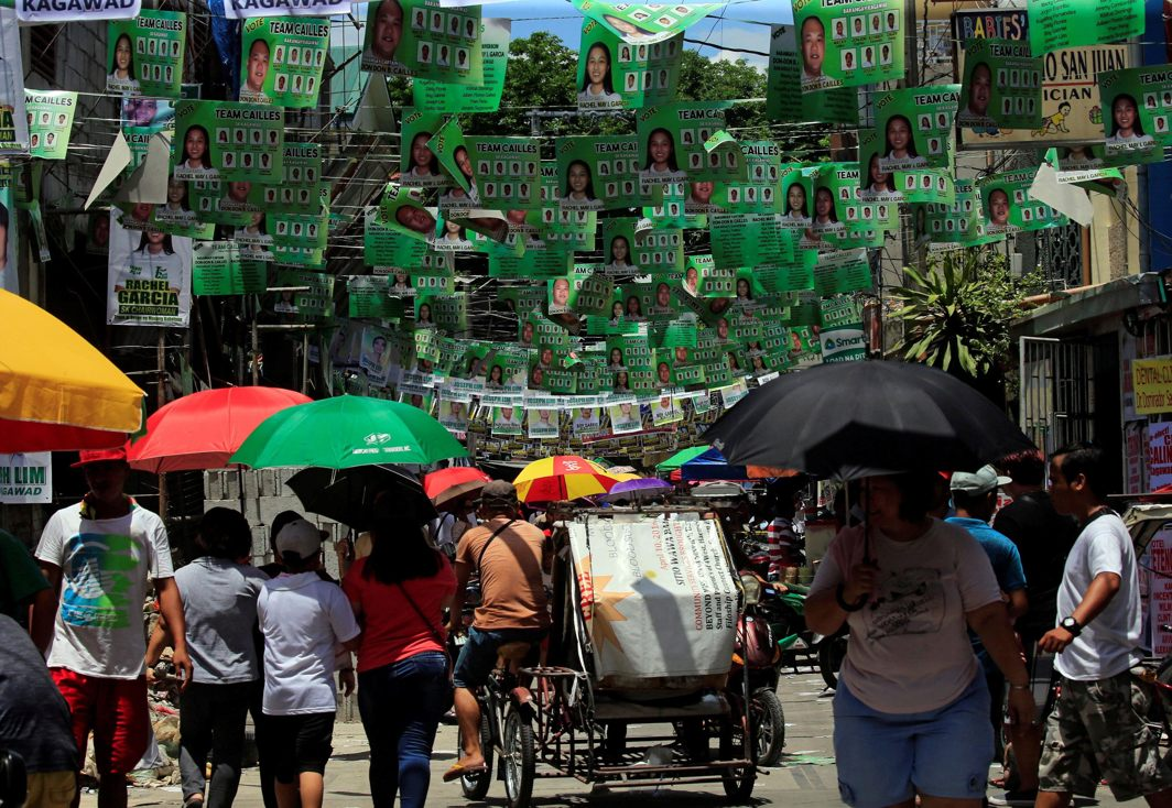 Election posters bearing the names and pictures of candidates are seen outside a polling station during the Village (Barangay) elections in Paranaque city, metro Manila, Philippines, Reuters/UNI