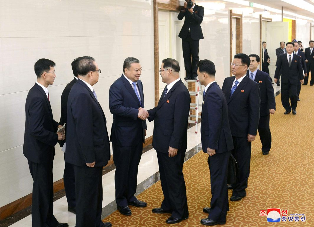 Pak Thae Song, member of North Korea's Political Bureau and vice-chairman of its Central Committee, shakes hands with Chinese Ambassador to North Korea Li Jinjun, as Pak leads a group of Workers' Party of Korea (WPK) visiting delegates to meet with Chinese officials, in Pyongyang, KCNA/Reuters/UNI