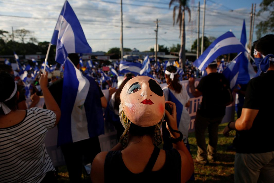 A masked protester takes part in a demonstration against President Daniel Ortega's government in Managua, Nicaragua, Reuters/UNI