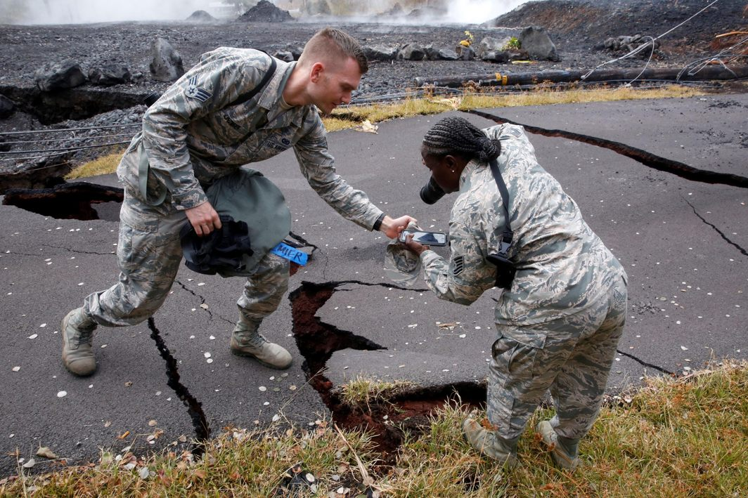 Senior Airman John Linzmeier and Technical Sergeant Alison Bruce-Maldonado of the Hawaii National Guard document road damage in Leilani Estates during ongoing eruptions of the Kilauea Volcano in Hawaii, US, Reuters/UNI