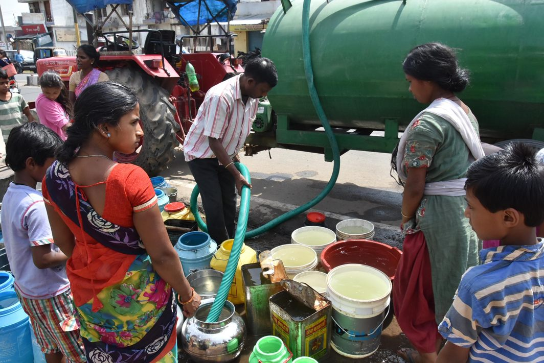 People collect water from a tanker during a hot summer day in Ranchi, UNI